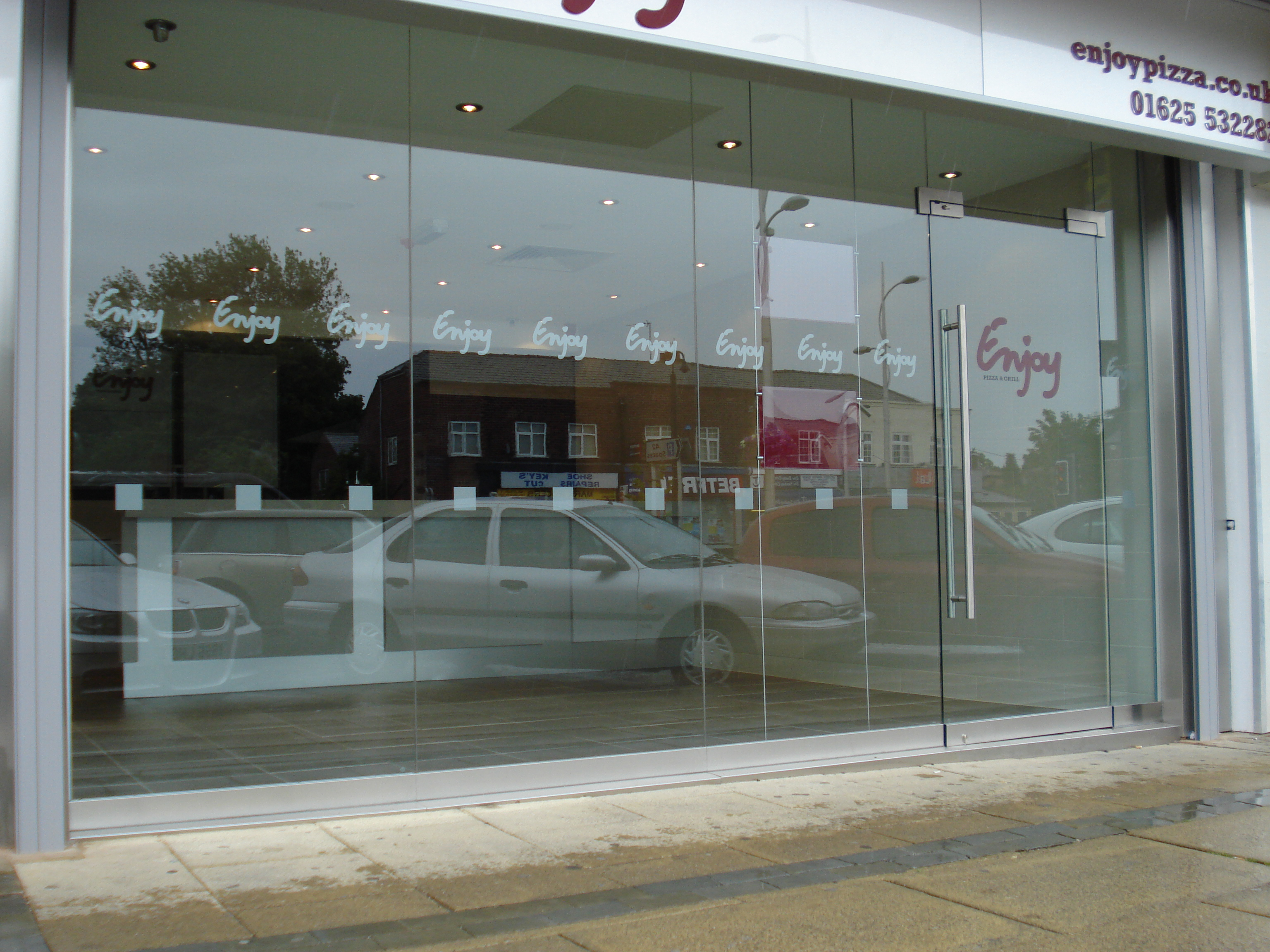 Toughened glass shop fronts combat doors manchester frameless toughened glass shop front planetlyrics Choice Image