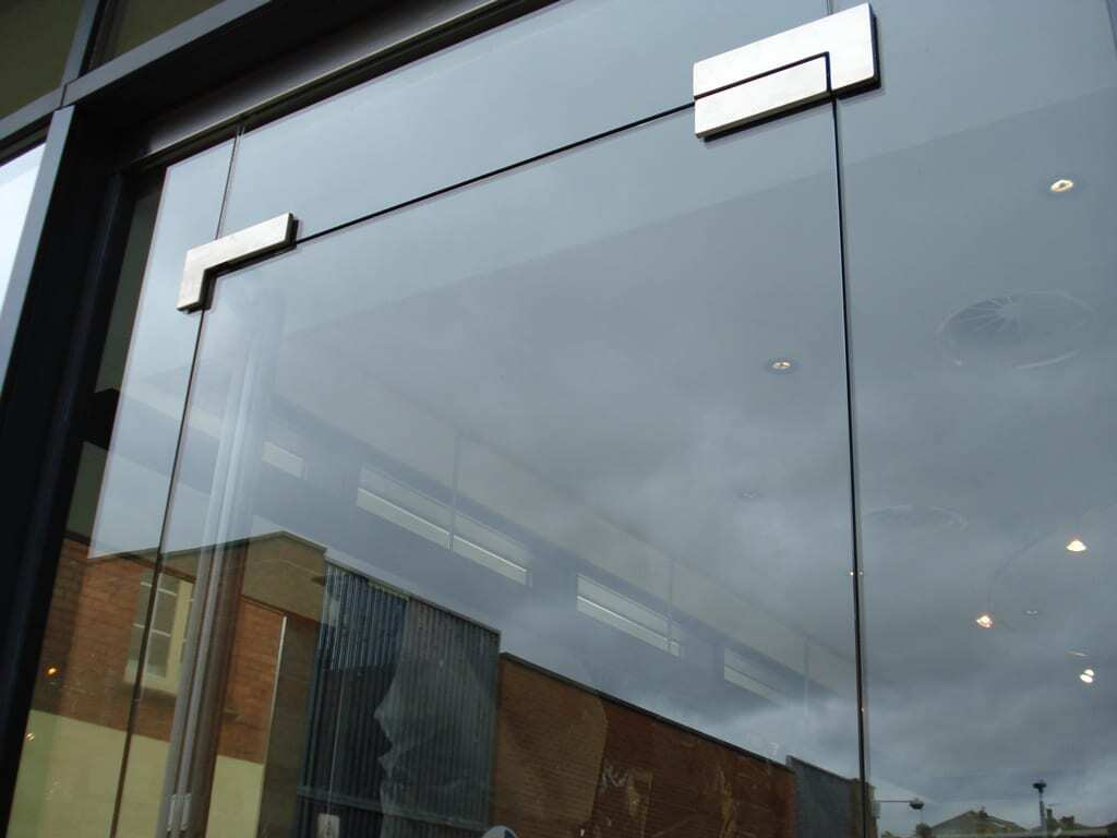 Toughened Glass Shop Fronts - Combat Doors Manchester