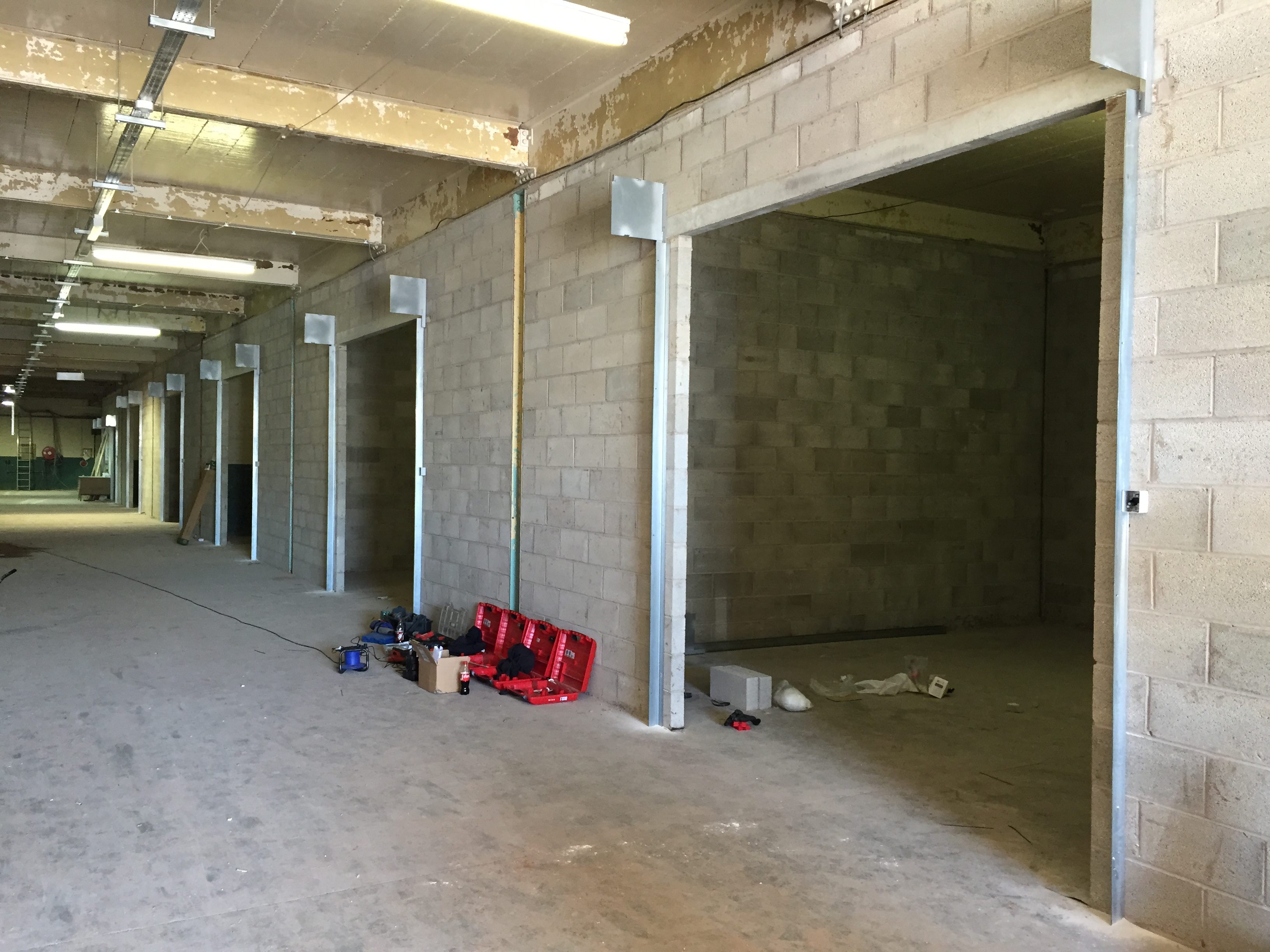 Installation of steel electrically operated roller shutters at a self storage complex in Warrington.